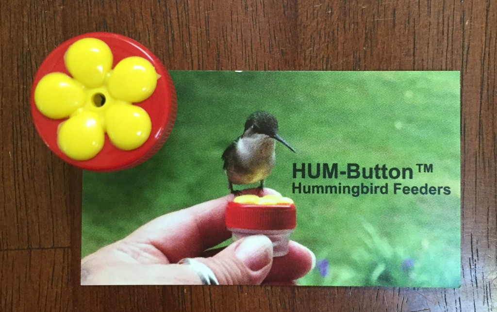 HUM-Button, hand-held hummingbird feeder
